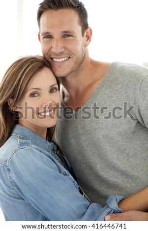 Portrait of a middle-aged couple in love, smiling and hugging