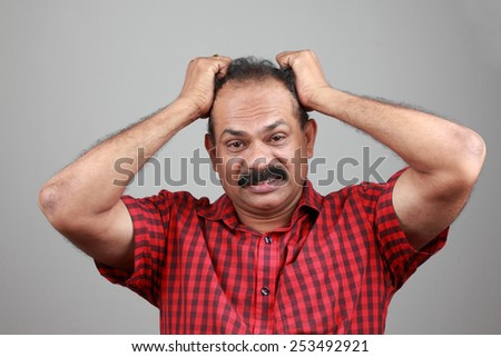Portrait of a middle aged depressed man  - stock photo