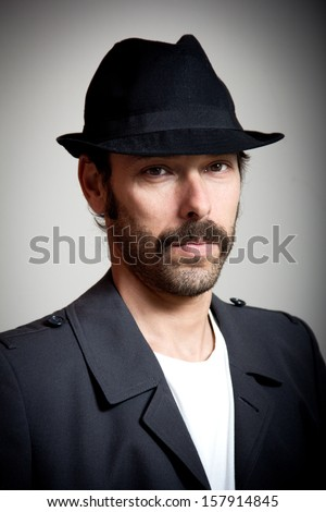 portrait of a middle aged man with gangster look - stock photo