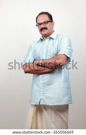 Portrait of a middle aged man with Kerala style traditional dress  - stock photo