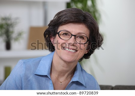 Portrait of a middle-aged smiling woman - stock photo