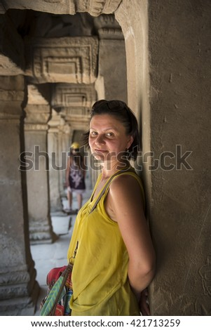 Portrait of a middle-aged woman in the gallery of the old building - stock photo