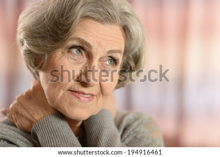 Portrait of a middle-aged woman isolated on colored background