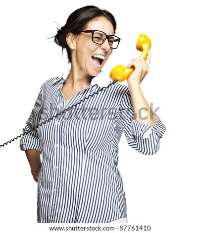 portrait of a middle aged woman talking on vintage telephone over white - stock photo