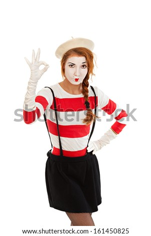 Portrait of a  mime comedian showing OK, isolated on white background  - stock photo