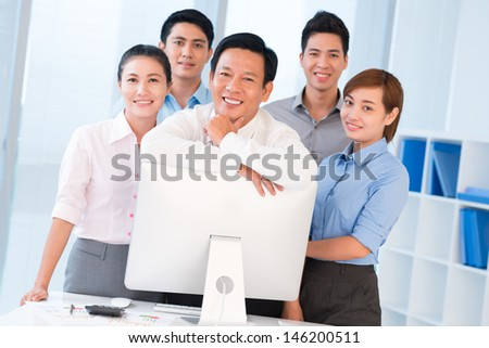 Portrait of a modern business team with its leader at the office