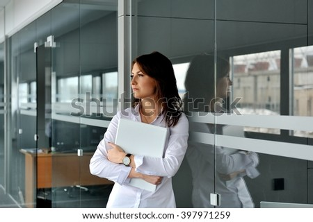 Portrait of a modern business woman in a business building. - stock photo