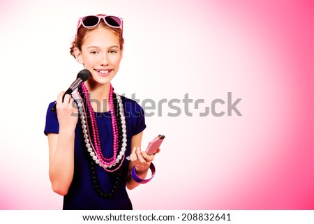 Portrait of a modern girl  over pink background. Teenager cosmetics. - stock photo