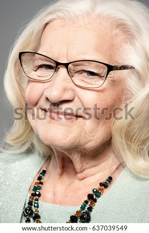Portrait of a modern senior woman with beautiful blonde hair. Studio shot. Beauty, fashion.