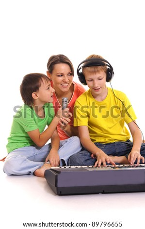 portrait of a mom and children with sintezator - stock photo