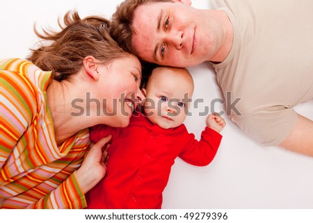 Portrait of a mom, dad and their cute baby - stock photo