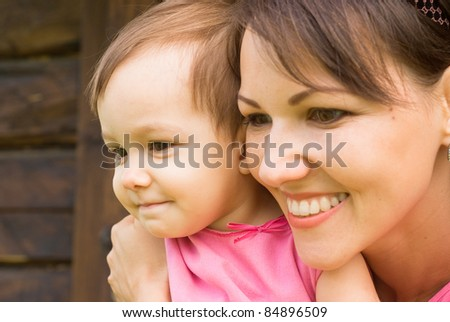 portrait of a mom with baby at nature