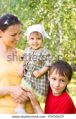 portrait of a mom with children at nature