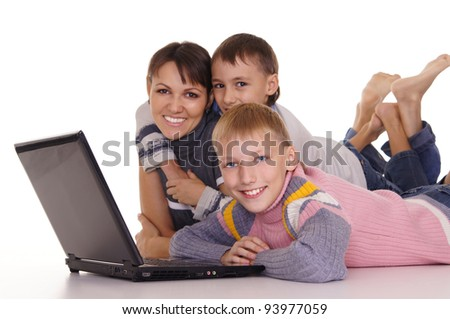 portrait of a mom with kids at laptop