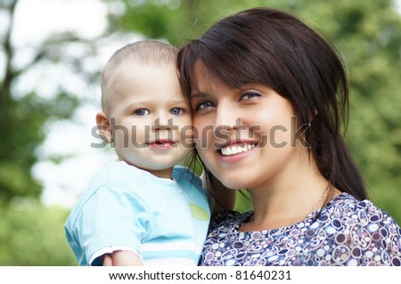 portrait of a mom with son at nature