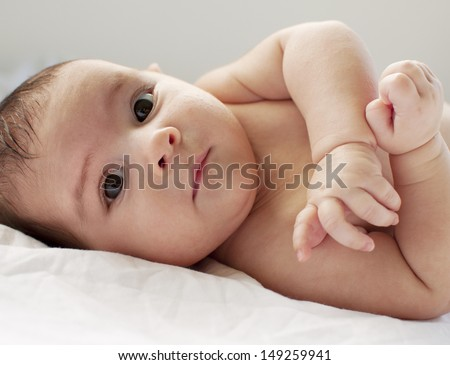 Portrait of a 2 month old baby - stock photo