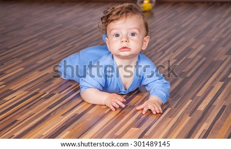 Portrait of a 7 months old baby boy at home. - stock photo