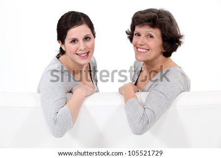 Portrait of a mother and her daughter - stock photo