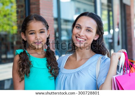 Portrait of a mother and her daughter at the mall