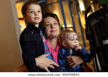 Portrait of a mother and her two sons in museum - stock photo