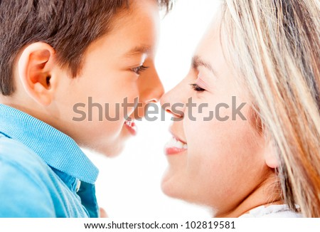 Portrait of a mother and son - isolated over a white background - stock photo