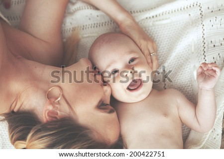 Portrait of a mother with her 3 months old baby - stock photo
