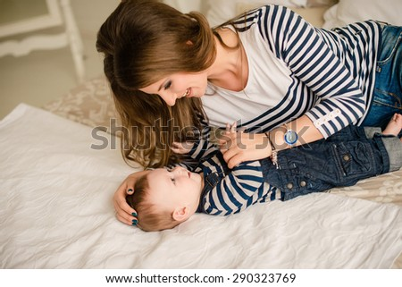 Portrait of a mother with her 6 months old baby - stock photo