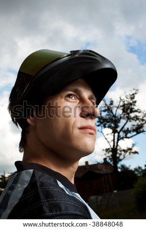 portrait of a motocross rider - stock photo