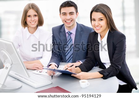 Portrait of a multi ethnic business team - stock photo