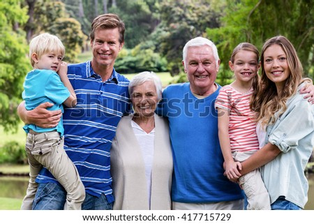 Portrait of a Multi-generation family standing in the park - stock photo