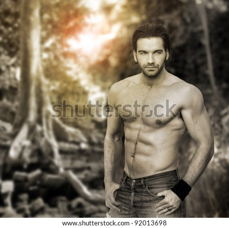 Portrait of a muscular masculine man in outdoor setting with stylized retro vintage look and tones - stock photo