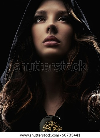 Portrait of a mysterious woman in hood - stock photo