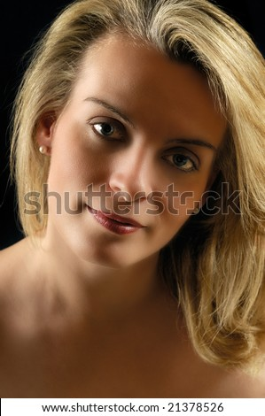 Portrait of a mystery girl in low light - stock photo
