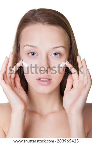 Portrait of a natural looking woman with moisturizer - stock photo