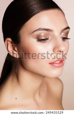 Portrait of a naturally beautiful girl with flawless perfect skin and wet eyeshadows makeup  - stock photo