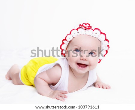 Portrait of a newborn baby girl indoors - stock photo