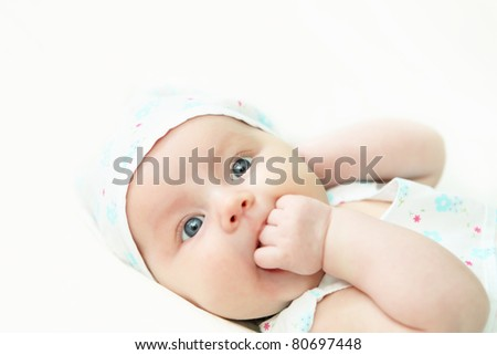 Portrait of a newborn baby girl indoors