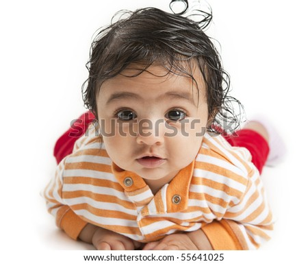 Portrait of a Newborn Baby Girl On Her Tummy, on white background - stock photo