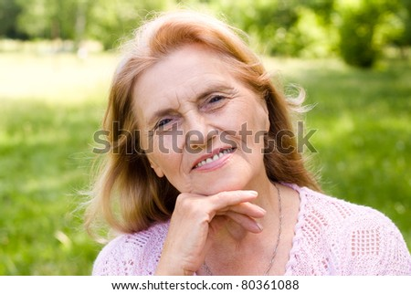 portrait of a nice aged woman at nature
