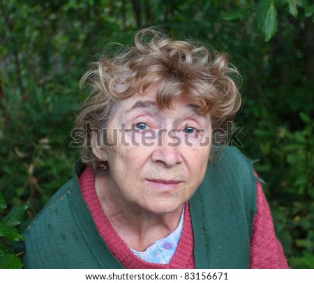 portrait of a nice aged woman at nature - stock photo