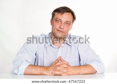 Portrait of a nice businessman on a white background