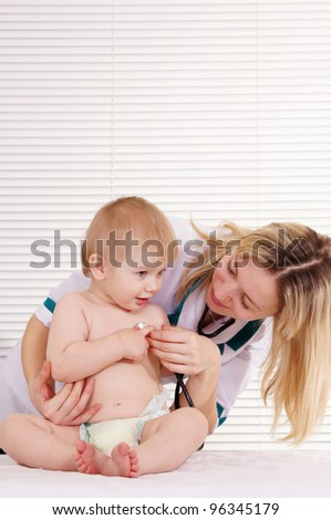 portrait of a nice doctor with baby - stock photo