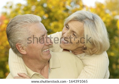 Portrait of a nice elderly couple in autumn park