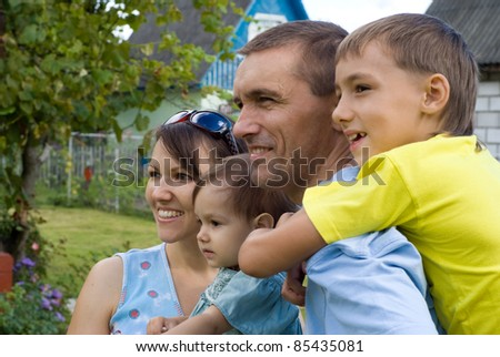 portrait of a nice family at nature