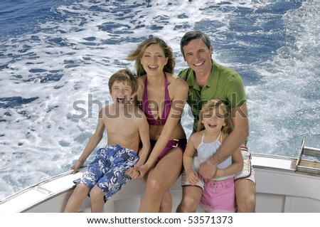 portrait of a nice family on a boat - stock photo