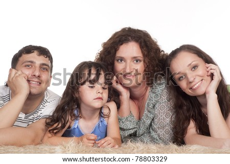 portrait of a nice family on a carpet