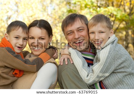 portrait of a nice family on the nature