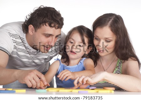 portrait of a nice family playing on white
