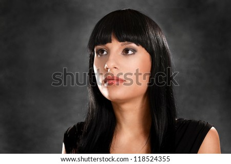 portrait of a nice girl on a black background - stock photo