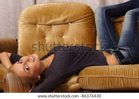 portrait of a nice girl posing at sofa